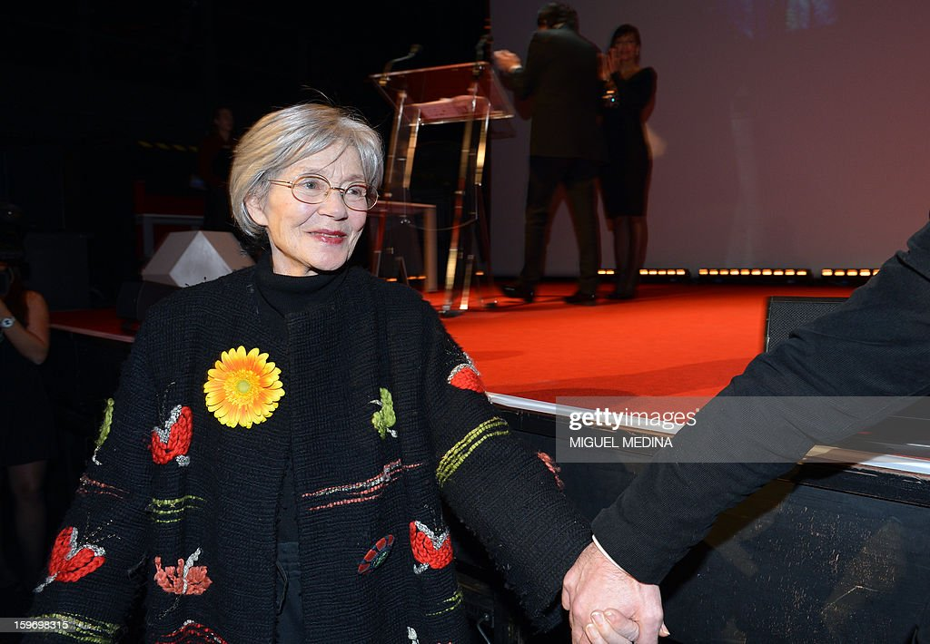 French actress Emmanuelle Riva (L) reacts before receiving on stage the best actress award for the film 'Amour' directed by Austrian filmmaker Michael Haneke during the 18th Lumieres awards ceremony, on January 18, 2013 at the Gaite Lyrique in Paris. International media journalists based in Paris from around 50 countries vote each year to award their own prizes to members of the French and francophone film industry. The Academy of the Lumieres paid this year a tribute to foreign actresses in French cinema and organised for the first time, the day before, the 'Francophone meetings' with hosted Tunisia, during which Tunisian director, Ferid Boughedir gave a masterclass.