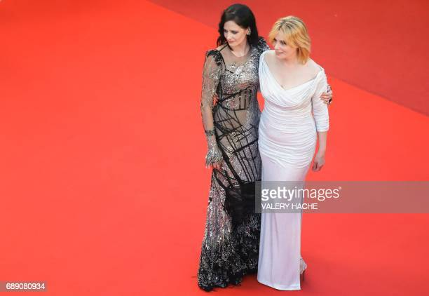 French actress Eva Green and French actress Emmanuelle Seigner pose as they leave the Festival Palace on May 27 2017 following the screening of the...