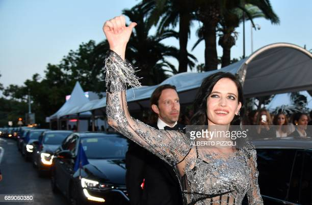 French actress Eva Green gestures as she leaves after signing autographs for fans on May 27 2017 following the screening of the film 'Based on a True...