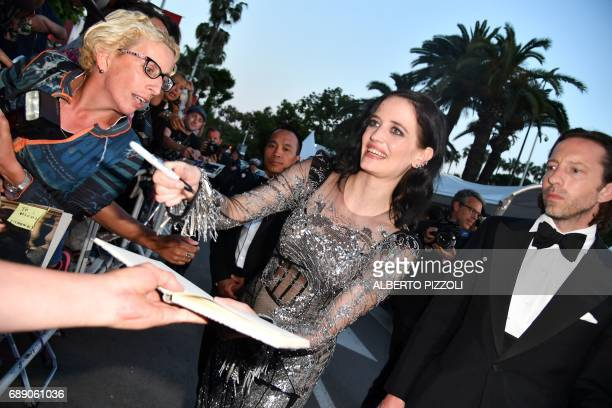 French actress Eva Green signs autographs for fans as he leaves on May 27 2017 following the screening of the film 'Based on a True Story' at the...