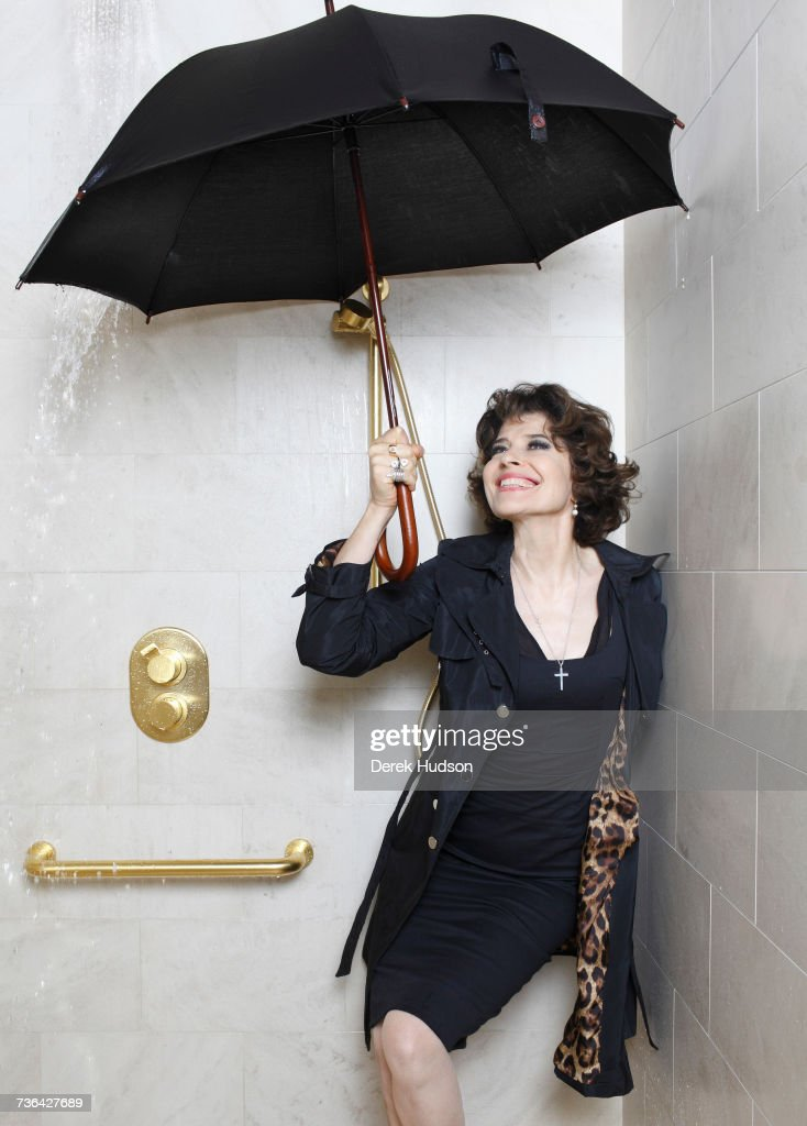 French actress Fanny Ardant photographed for a feature in the French magazine, Marie-Claire, standing in a shower of a luxury bathroom of a hotel on the Rue de la Paix in Paris.