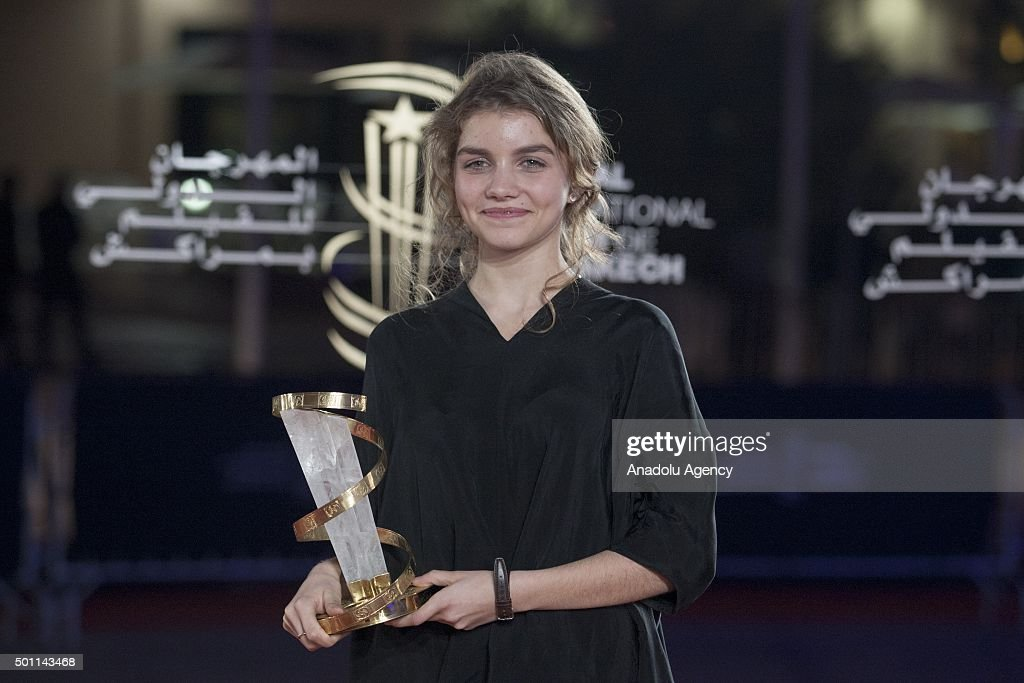 French actress Galatea Bellugi holds her Best Actredd award for her performance in the movie 'Keeper' at the closing ceremony during the 15th...