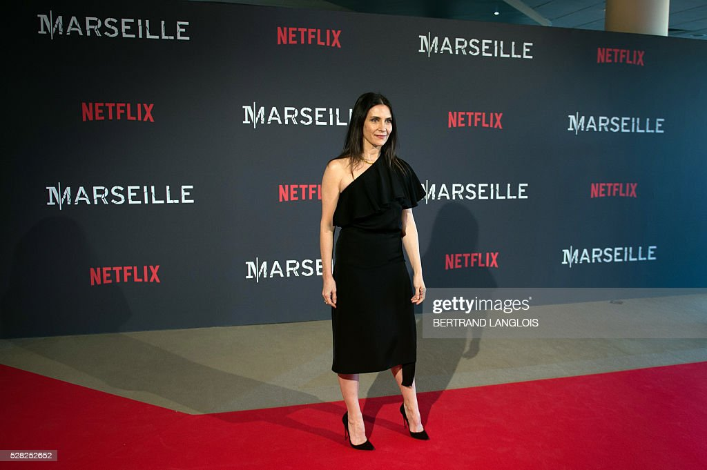 French actress Geraldine Pailhas poses during a photocall for the premiere of the French TV show 'Marseille' broadcasted and co-produced by Netflix on May 4, 2016 in Marseille, southern France. / AFP / BERTRAND