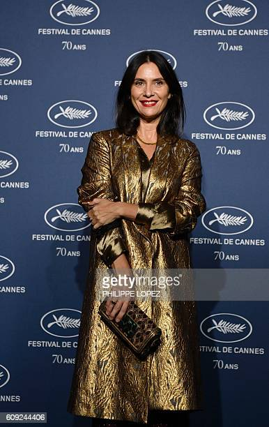 French actress Géraldine Pailhas poses as she arrives for a ceremony marking the 70th anniversary of the Cannes International Film Festival on...