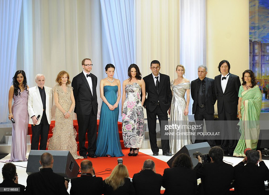 French actress Hafsia Herzi French singer Charles Aznavour pose with jury members French actress and president of the jury Isabelle Huppert US...