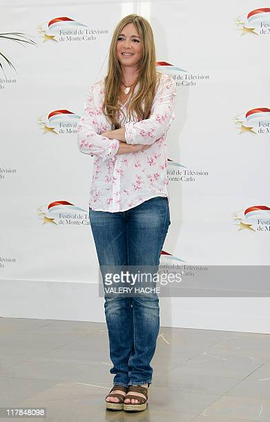 French actress Helene Rolles poses during a photocall for the TV show 'Les mysteres de l'amour' as part of the 2011 Monte Carlo Television Festival...