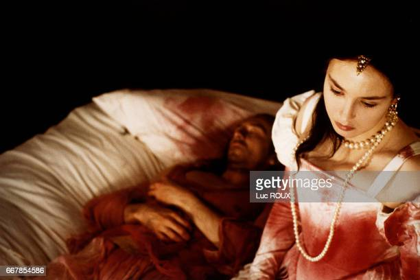 French actress Isabelle Adjani and French actor JeanHugues Anglade on the set of the 1994 film La Reine Margot directed by Patrice Chereau
