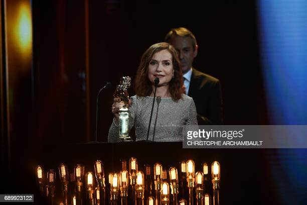 French actress Isabelle Hupert holds her trophy after she won a 'Moliere d'honneur' at the Folies Bergeres Theatre in Paris on May 29 2017 during the...