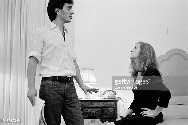 French actress Isabelle Huppert and director Ronald Chammah on the set of his film 'Milan noir'