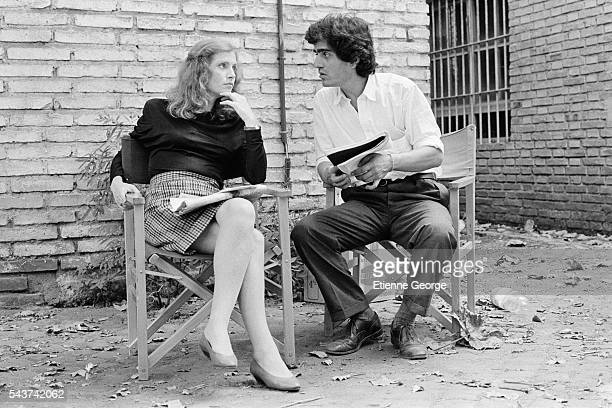 French actress Isabelle Huppert and director Ronald Chammah the set of his film 'Milan noir'