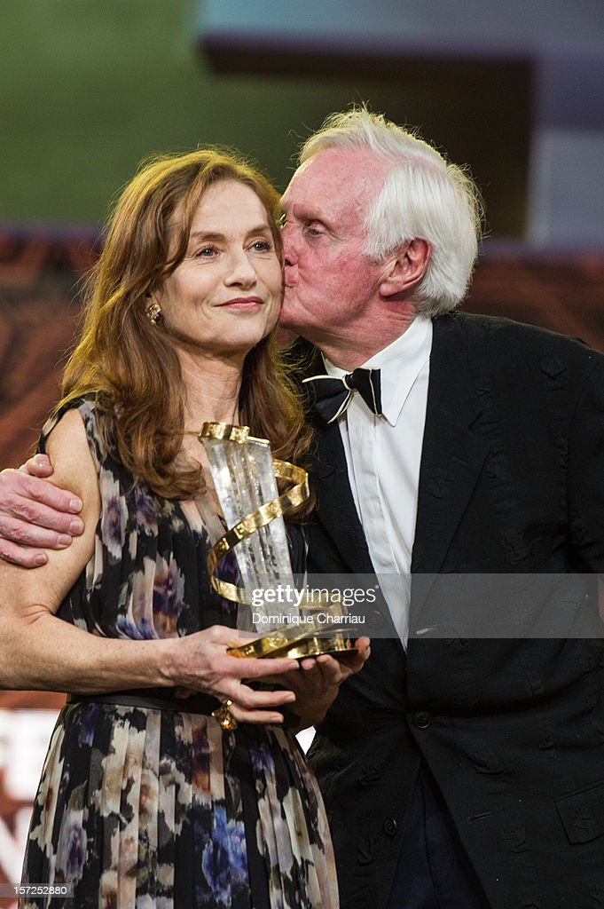 French Actress <a gi-track='captionPersonalityLinkClicked' href=/galleries/search?phrase=Isabelle+Huppert&family=editorial&specificpeople=662796 ng-click='$event.stopPropagation()'>Isabelle Huppert</a> and <a gi-track='captionPersonalityLinkClicked' href=/galleries/search?phrase=John+Boorman&family=editorial&specificpeople=213769 ng-click='$event.stopPropagation()'>John Boorman</a> pose during her tribute during the opening ceremony of the 12th Marrakech International Film Festival on November 30, 2012 in Marrakech, Morocco.