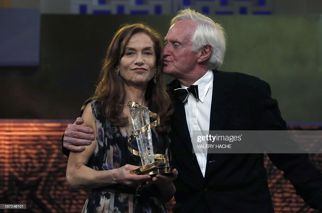 French actress Isabelle Huppert and President of the jury John Boorman pose during the opening ceremony of the 12th Marrakesh International Film Festival on November 30, 2012 in Marrakesh. AFP PHOTO / VALERY HACHE