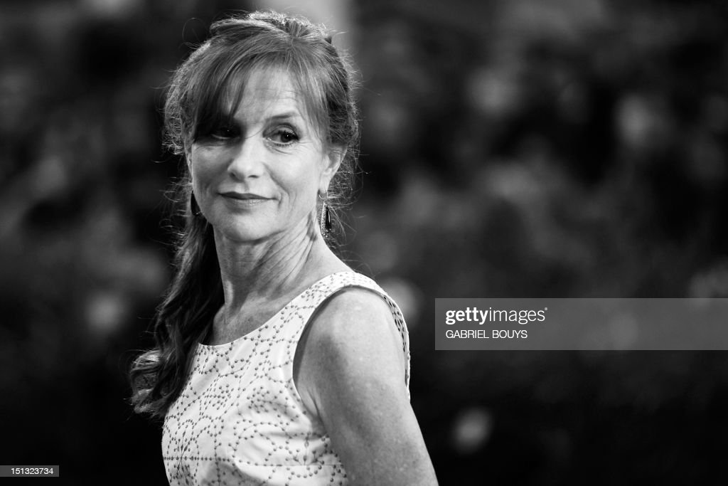 French actress Isabelle Huppert arrives for the screening of 'Bella addormentata' during the 69th Venice Film Festival on September 5, 2012 at Venice Lido. 'Bella addormentata' is competing for the Golden Lion in the Venezia 69 section of the festival. AFP PHOTO / GABRIEL BOUYS