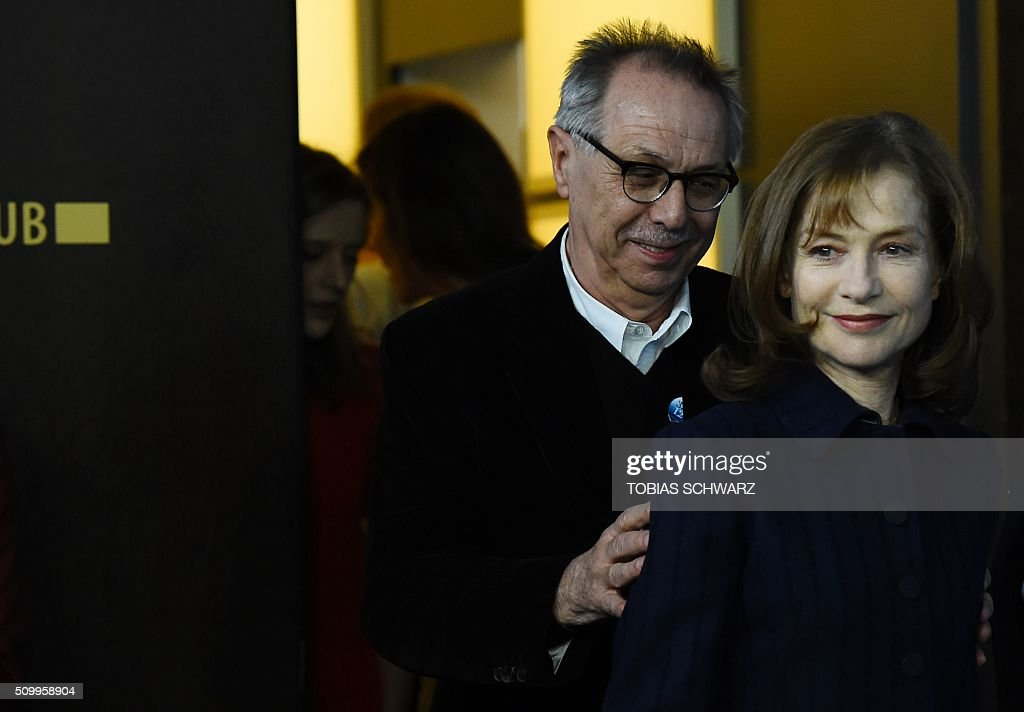 French actress Isabelle Huppert (R) arrives with festival director Dieter Kosslick poses for a photo call for the film 'L'Avenir' (Things to Come) in competition at the 66th Berlinale Film Festival in Berlin on February 13, 2016. / AFP / TOBIAS SCHWARZ
