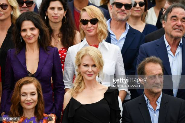 French actress Isabelle Huppert Australian actress Nicole Kidman and French actor Vincent Lindon French actress Juliette Binoche US actress Uma...