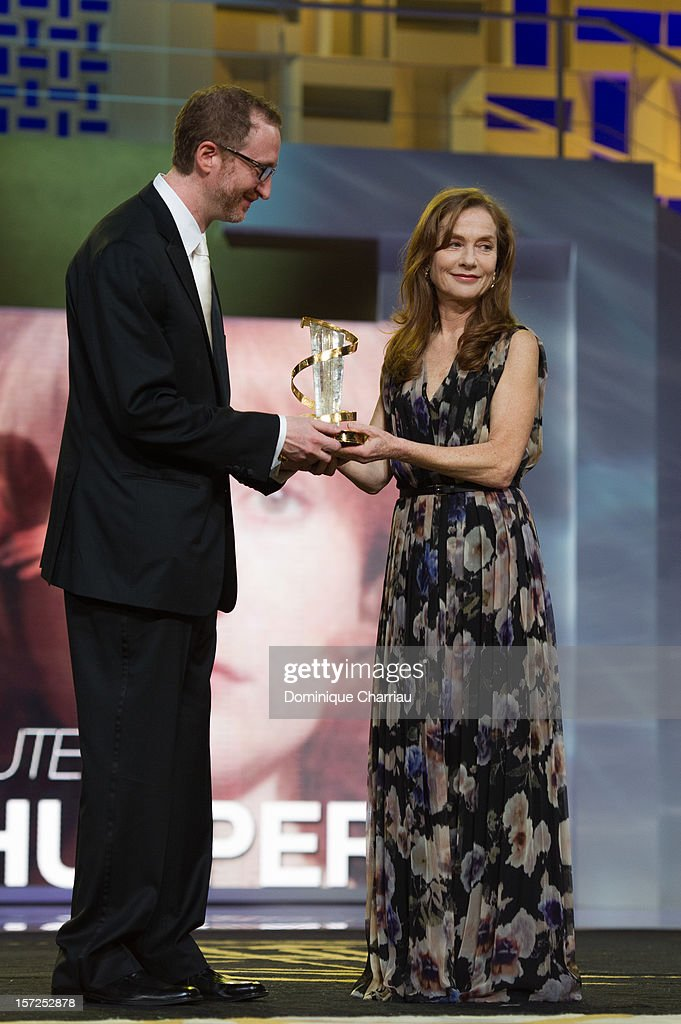 French Actress Isabelle Huppert awarded by James gray during her tribute during the opening ceremony of the 12th Marrakech International Film Festival on November 30, 2012 in Marrakech, Morocco.