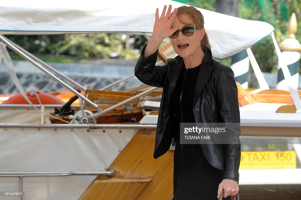French actress Isabelle Huppert boards a boat at Venice Lido during the 69th Venice Film Festival on September 7, 2012. AFP PHOTO / TIZIANA FABI