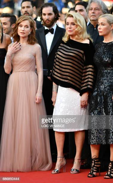 French actress Isabelle Huppert French actress Catherine Deneuve and French actress Emmanuelle Beart pose as they arrive on May 22 2017 for the...