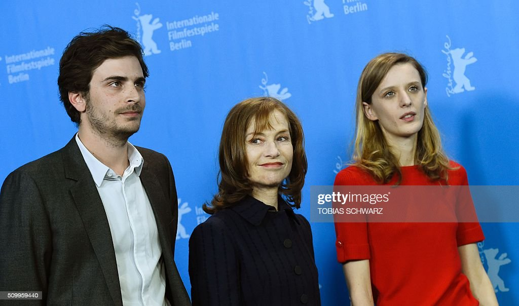 French actress Isabelle Huppert (L), French director Mia Hansen-Love and French actor Roman Kolinka pose during a photo call for the film 'L'Avenir' (Things to Come) in competition at the 66th Berlinale Film Festival in Berlin on February 13, 2016. / AFP / TOBIAS SCHWARZ