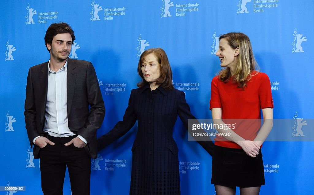 French actress Isabelle Huppert (C), French director Mia Hansen-Love (R) and French actor Roman Kolinka pose during a photo call for the film 'L'Avenir' (Things to Come) in competition at the 66th Berlinale Film Festival in Berlin on February 13, 2016. / AFP / TOBIAS SCHWARZ
