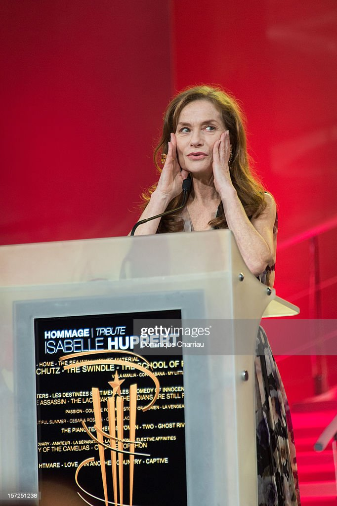 French Actress Isabelle Huppert gives a speach befor her tribute during the opening ceremony of the 12th Marrakech International Film Festival on November 30, 2012 in Marrakech, Morocco.