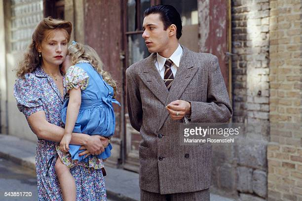 French actress Isabelle Huppert her daughter Lolita Chammah and actor Nils Tavernier on the set of 'Story of Women' by French director screenwriter...