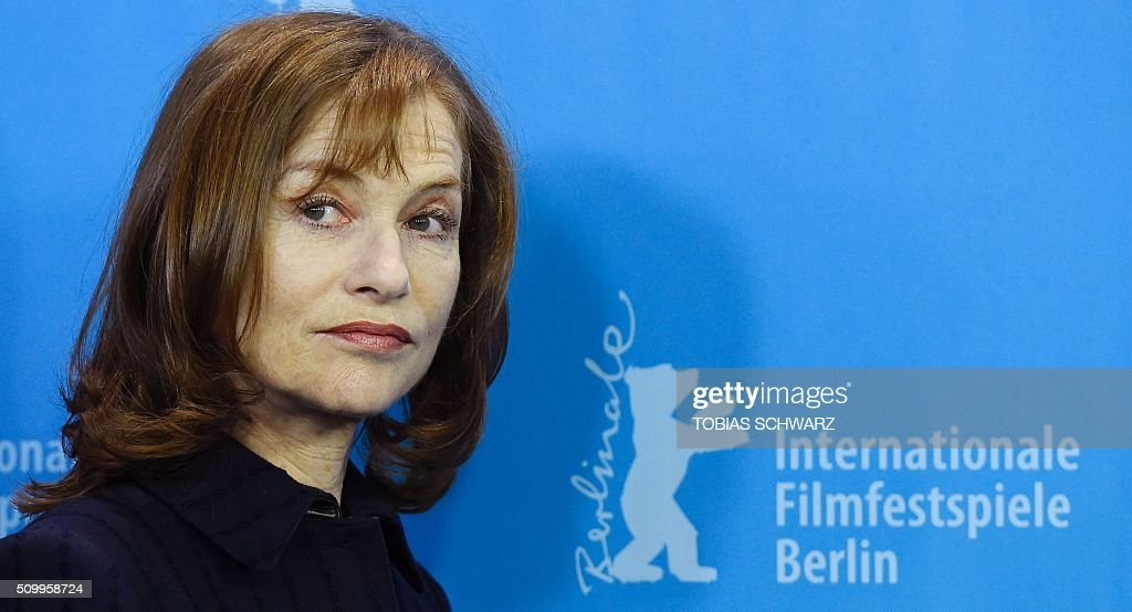 French actress Isabelle Huppert poses during a photo call for the film 'L'Avenir' (Things to Come) in competition at the 66th Berlinale Film Festival in Berlin on February 13, 2016. / AFP / TOBIAS SCHWARZ