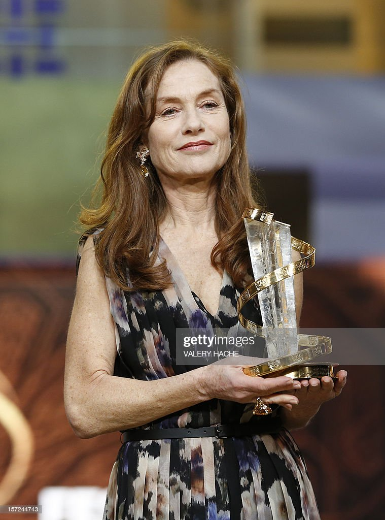 French actress Isabelle Huppert poses during the opening ceremony of the 12th Marrakesh International Film Festival on November 30, 2012 in Marrakesh.
