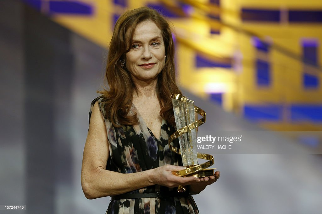 French actress Isabelle Huppert poses during the opening ceremony of the 12th Marrakesh International Film Festival on November 30, 2012 in Marrakesh. AFP PHOTO / VALERY HACHE