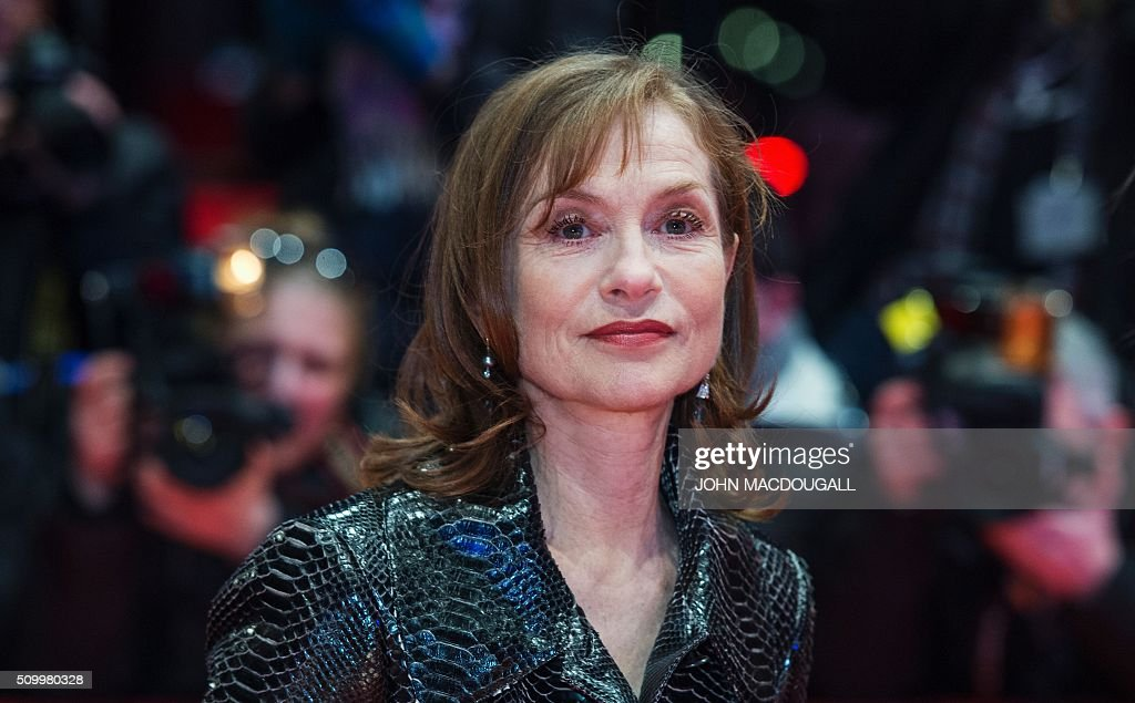 French actress Isabelle Huppert poses for photographers on the red carpet for the film 'L'Avenir' (Things to Come) in competition at the 66th Berlinale Film Festival in Berlin on February 13, 2016. / AFP / John MACDOUGALL