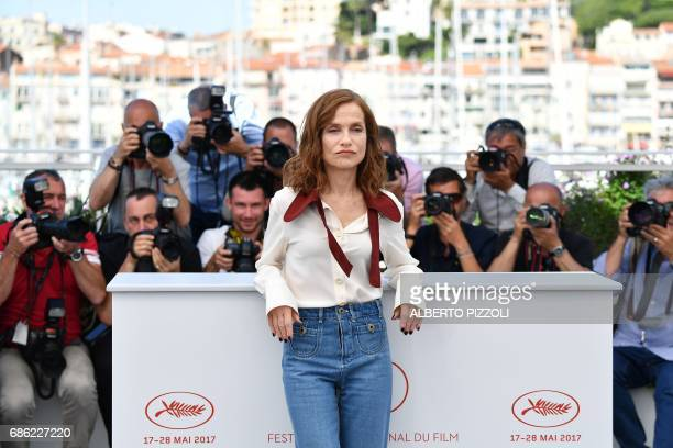 French actress Isabelle Huppert poses on May 21 2017 during a photocall for the film 'Claire's Camera ' at the 70th edition of the Cannes Film...