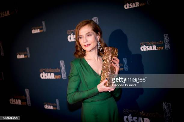 French actress Isabelle Huppert poses with the Cesar award for best actress during the Cesar Film Awards 2017 at Salle Pleyel on February 24 2017 in...