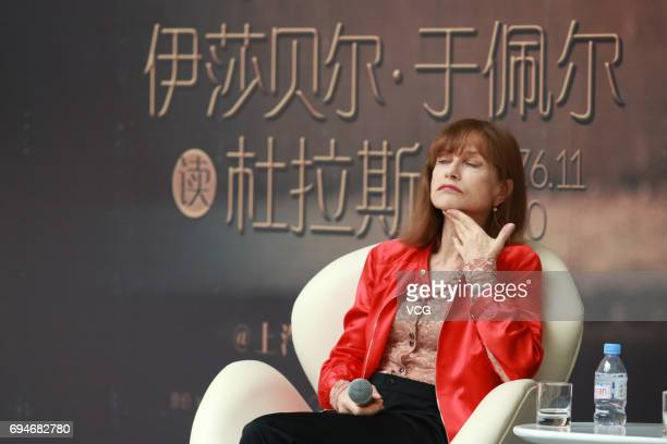French actress Isabelle Huppert talks with Chinese director Jia Zhangke during 'Isabelle Huppert reads Marguerite Duras' on June 10 2017 in Shanghai...