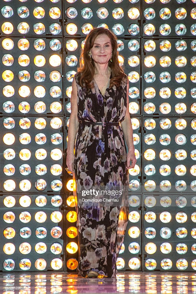 French Actress <a gi-track='captionPersonalityLinkClicked' href=/galleries/search?phrase=Isabelle+Huppert&family=editorial&specificpeople=662796 ng-click='$event.stopPropagation()'>Isabelle Huppert</a>arrives to her tribute during the opening ceremony of the 12th Marrakech International Film Festival on November 30, 2012 in Marrakech, Morocco.