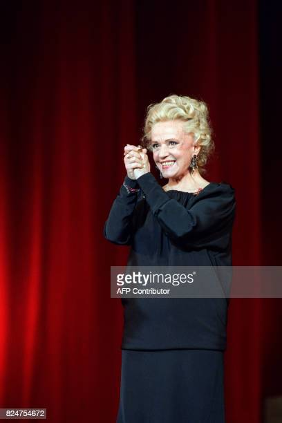 French actress Jeanne Moreau acknowledges the audience of the Chatelet theater during the 3th Moliere theatre awards ceremony on May 7 1989 AFP PHOTO...