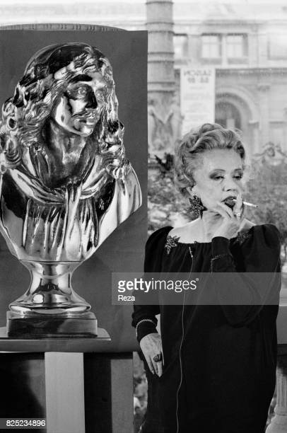 French actress Jeanne Moreau next to the poster of the Nuit des Molière on May 10 1989