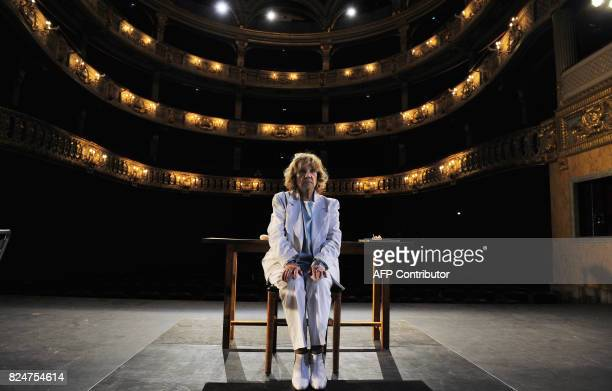 French actress Jeanne Moreau performs in a rehearsal of the play 'La Guerre des Fils de Lumiere contre les fils des tenebres' an adaptation of 'The...