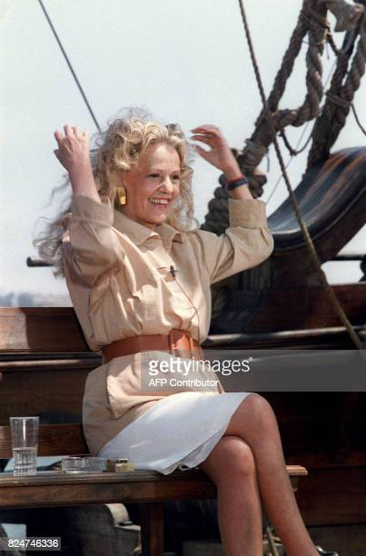 French actress Jeanne Moreau poses on board of the boat used for the filming of 'Pirates' directed by Roman Polanski where she attends a tv show for...