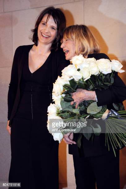 French actress Jeanne Moreau shares a laugh with French actress Juliette Binoche during a ceremony celebrating the 60th anniversary of her career 06...