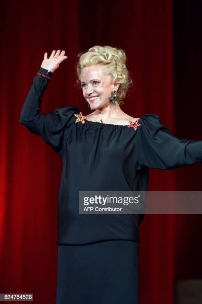 French actress Jeanne Moreau waves the audience of the Chatelet theater during the 3th Moliere theatre awards ceremony on May 7 1989 AFP PHOTO PIERRE...