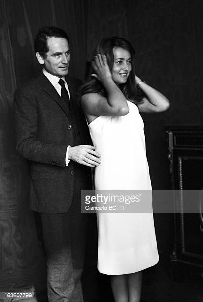 French actress Jeanne Moreau with French fashion designer Pierre Cardin trying on a dress designed by Pierre Cardin in France in September 1965