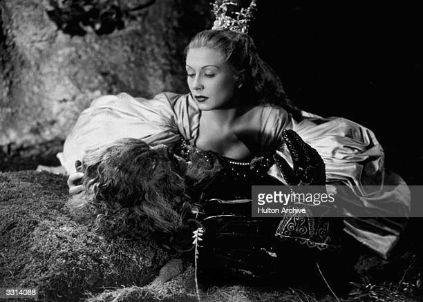 French actress Josette Day kneels over the stricken Beast played by Jean Marais in Jean Cocteau's beautifully surreal film 'La Belle Et La Bete'...