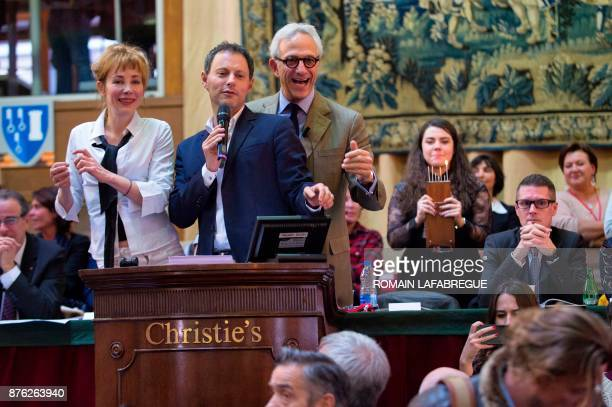 French actress Julie Depardieu French radio and TV host MarcOlivier Fogiel and French auctioneer Francois De Ricqles conduct the 157th charity wine...