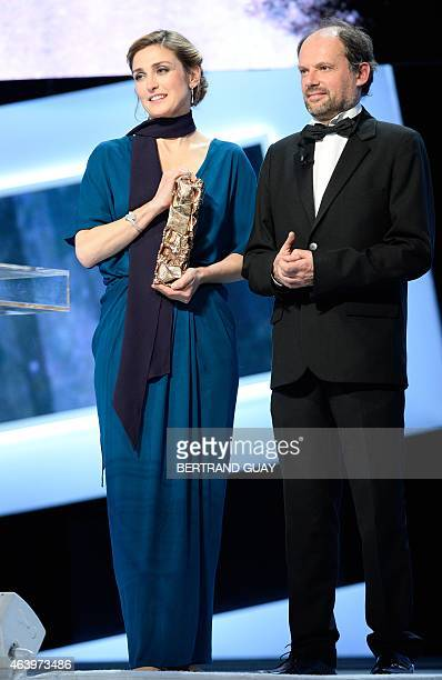 French actress Julie Gayet and actor Denis Podalydes arrive on stage to present the Best Male Newcomer award during the 40th edition of the Cesar...