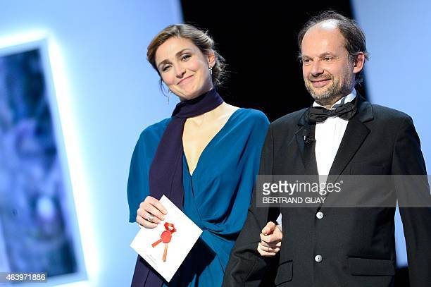 French actress Julie Gayet and French actor Denis Podalydes arrive to present the Best Male Newcomer award during the 40th edition of the Cesar...