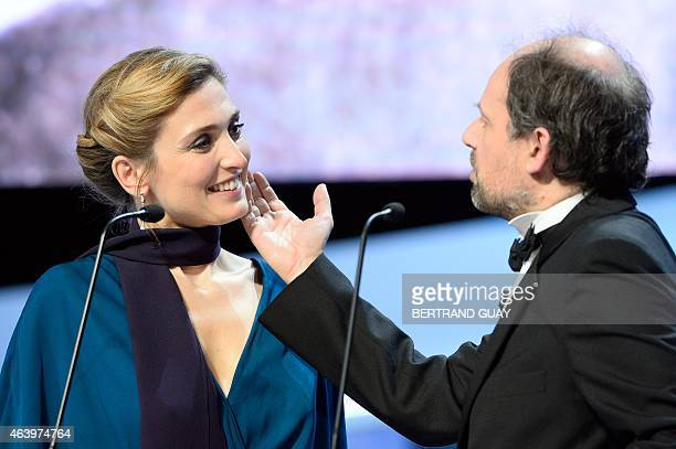 French actress Julie Gayet and French actor Denis Podalydes present the Best Male Newcomer award during the 40th edition of the Cesar Awards ceremony...