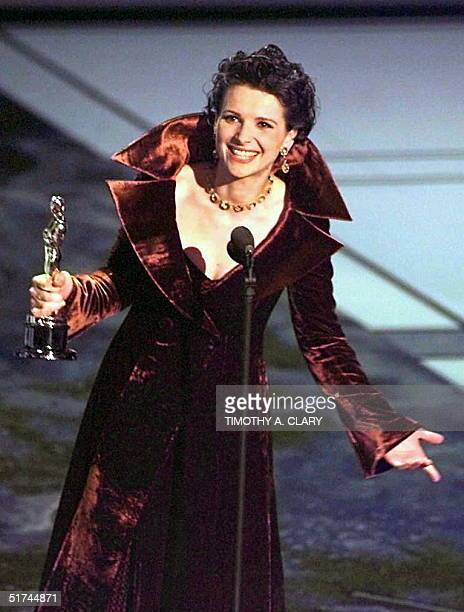 French actress Juliette Binoche holds her Oscar after winning the Best Supporting Actress Oscar for her role in 'The English Patient' during the 69th...