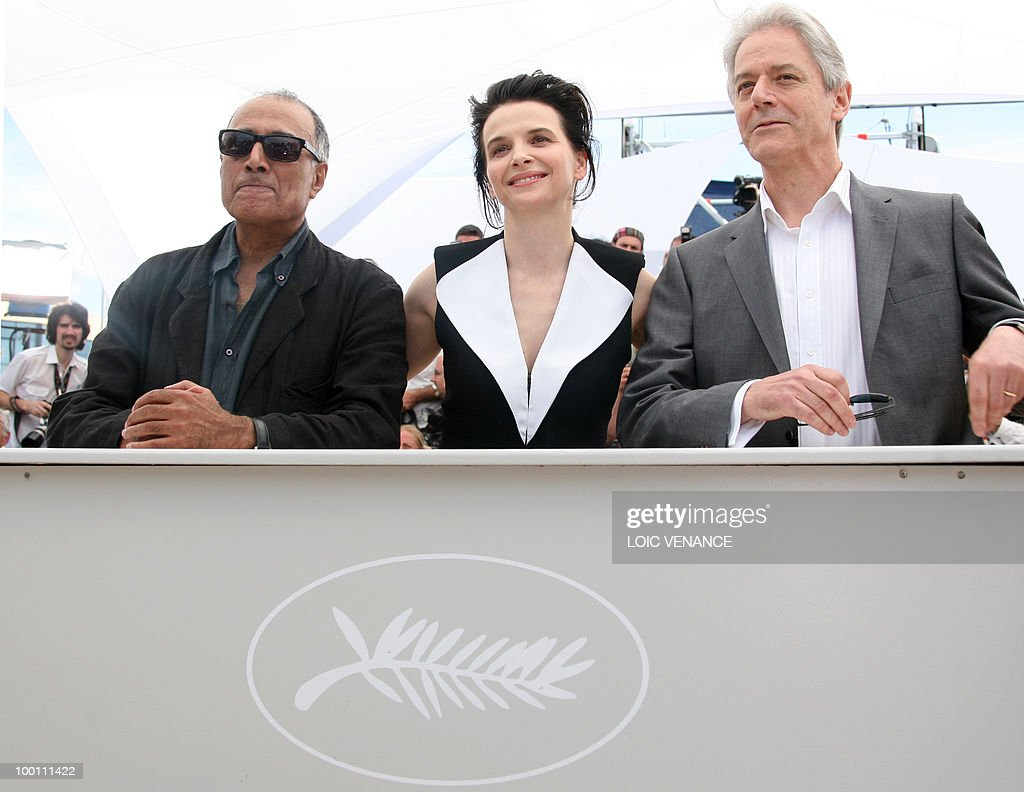 French actress Juliette Binoche (C), Iranian director Abbas Kiarostami (L) and British actor William Shimell pose during the photocall of 'Copie Conforme' (Certified Copy) presented in competition at the 63rd Cannes Film Festival on May 18, 2010 in Cannes.
