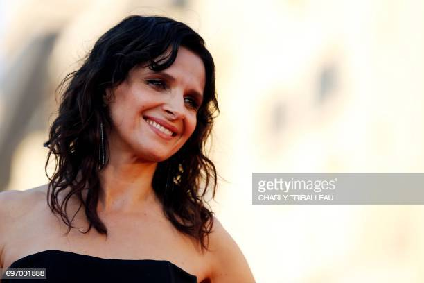 TOPSHOT French actress Juliette Binoche poses on the red carpet on June 17 2017 during the Cabourg Romantic Film Festival in Cabourg northwestern...