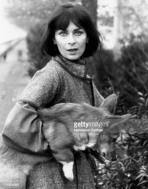 French actress Juliette Mayniel holding a Welsh Corgi dog Rome 1970s